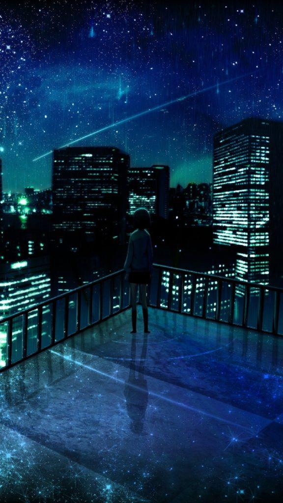 девушка на крыше здания ночью